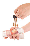 House key in hand and cash money Stock Image