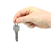 House key in hand Stock Photos