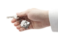 House key in hand isolated on white Royalty Free Stock Image