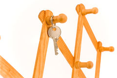 House key hanging on wooden hook Stock Image