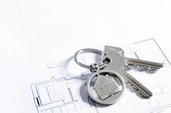 House key on a house shaped pendant. Real estate agent business card template royalty free stock photos