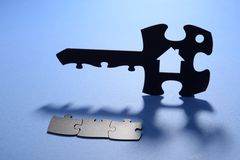 House key with jigsaw puzzle code Royalty Free Stock Photography