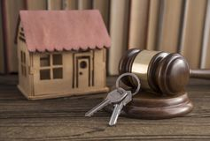 House, key, judge hammer on a books background. stock photography