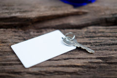 House key and keycard on wooden floorboards Stock Images