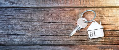 House Key And Keychain On Wood. En Table Royalty Free Stock Image