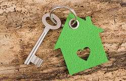House key on keyring. With green model house Royalty Free Stock Image