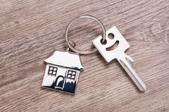 House key on keyring. With model house Stock Photography