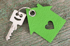 House key on keyring. With model house Stock Photo