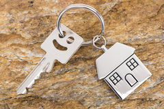 House key on keyring. With model house Royalty Free Stock Image