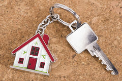House key on keyring. With model house Royalty Free Stock Images