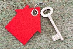 House key on keyring. Single house key on keyring with symbol of red house Stock Photos