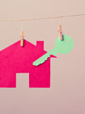 House with key on laundry line Royalty Free Stock Images