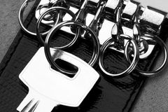 House key in leather holder Stock Images