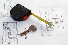 House key, measure and architectural plan. House key, measure over architectural plan royalty free stock photography