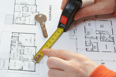 House key, measure and architectural plan. House key, measure over architectural plan royalty free stock photos