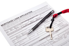 Mortgage loan. House key with mortgage loan application Real estate investment and finance concept stock photo