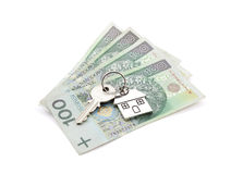 House key on pile of polish banknotes Stock Images