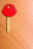 House key with red plastic coats caps on table Stock Photography