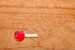 House key with red plastic coats caps on table Royalty Free Stock Image