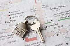 House key on ring. On set of plans stock image