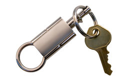 House Key Ring. Brass House Key and Silver Trinket.  Isolated, All Clipping Pathes included Stock Photo