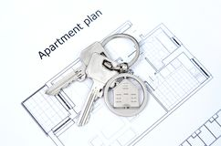 House key on a house shaped pendant. Real estate agent concept on white background royalty free stock images