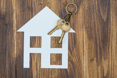 House with key on wooden background, new house Royalty Free Stock Photo