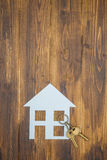 House with key on wooden background, new house Royalty Free Stock Images