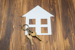 House with key on wooden background, new house Stock Photography