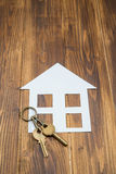 House with key on wooden background, new house Royalty Free Stock Photos