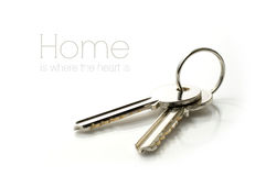 House Keys. Studio macro of stainless steel house keys on glass against a white background. Copy space royalty free stock images