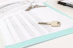 House keys on an amortization schedule Stock Photo