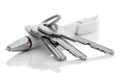 House keys and ballpoint pen. Royalty Free Stock Image