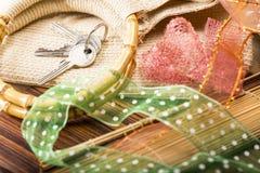 House keys, bamboo handles of a shopping bag Royalty Free Stock Photo
