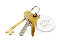 House keys blank tab. A set of house keys with clear plastic Key fob or tab with blank area and clipping path Stock Images