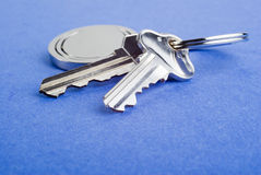 House Keys on Blue Textured Background Stock Photo