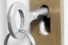 House Keys in Door Lock. Stock Photo