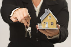 House and Keys in Female Hands Royalty Free Stock Images