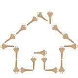 House keys form a home shape. Brass house keys form the shape of a home for your real estate or other home related design Royalty Free Stock Images