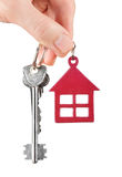 House keys in hand isolated on white Royalty Free Stock Images