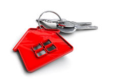 House keys with house icon keyring. Concept for property ownership. Royalty Free Stock Image