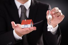 House and keys on palm of hand. Small house and keys on palm of hand Royalty Free Stock Images