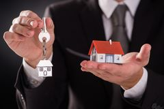 House and keys on palm of hand. Small house and keys on palm of hand Stock Photography