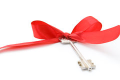 House keys with red ribbon Stock Photo