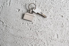 House keys symbol on grey concrete wall or cement background. Stock Images