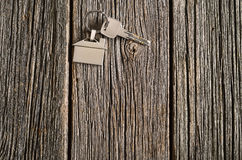 House keys symbol on old wooden floor background. Royalty Free Stock Photo