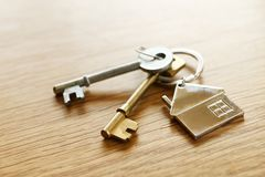 House keys on a table. A set of House keys on a table royalty free stock photography