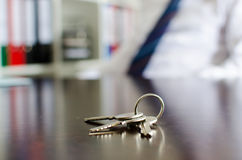 House keys on a table Stock Photo