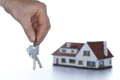 House and keys on white background Stock Photo