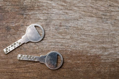 House keys on wooden background Stock Images